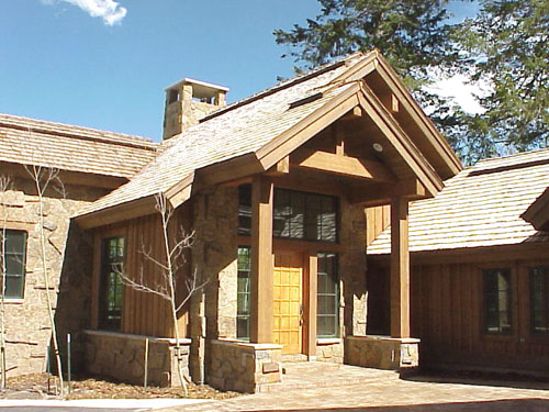 """This 5,500 s.f. residence has 4 bedrooms and 4-1/2 baths.  The entry porch is protected by a deep gable end roof held up with 12""""X12"""" RS Cedar columns."""
