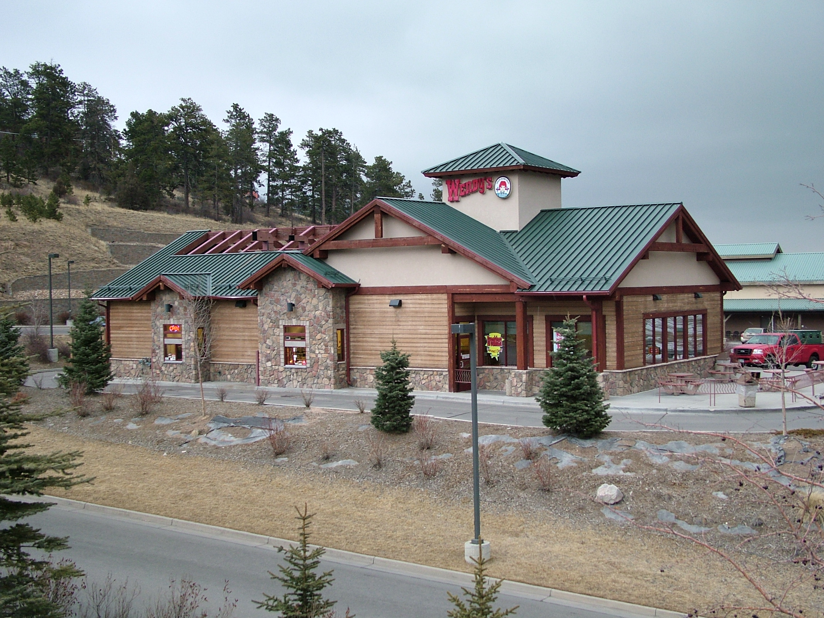 This view shows the main entrance. The building is an adaptation of the owner's Eagle Wendy's prototype that we developed to better reflect mountain architecture.  This version was revised to comply with Conifer's design guidelines.