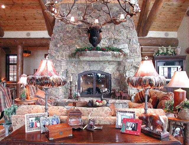 The great room has vaulted ceilings with log trusses, a large stone fireplace, deck access, and views that look above the Aspen forest to Castle Peak. The great room and dining room  space is large, but also comfortable.