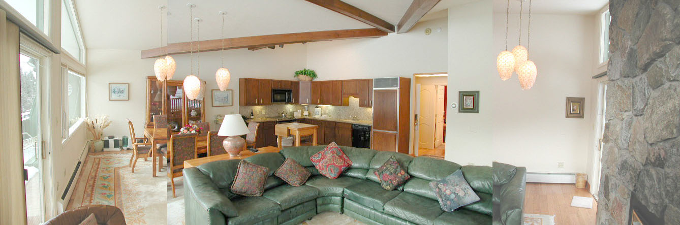 This is a  view of the living room and kitchen before reconstruction. The kitchen and dining area have been relocated to the right side of this room.  The fireplace remains in its original location, but it has been re-veneered with Colorado buff sandstone.