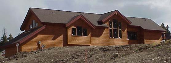 Located on the west side of the residence are all three bedrooms with the master suite to the far right.  The tall windows in this elevation are in the dining room.