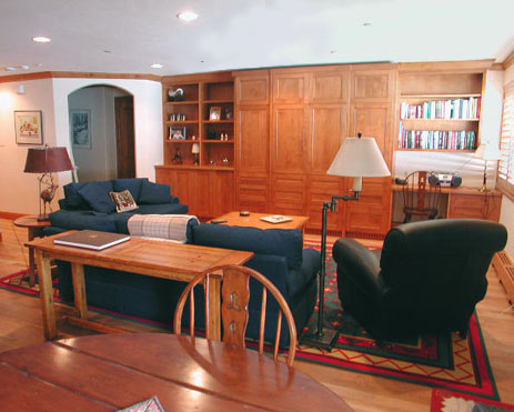 This is an interior view of the new living room.  The existing living area was sub-divided by a moveable partition. The upper left corner of the picture shows the new entry vestibule opening directly into the living area.