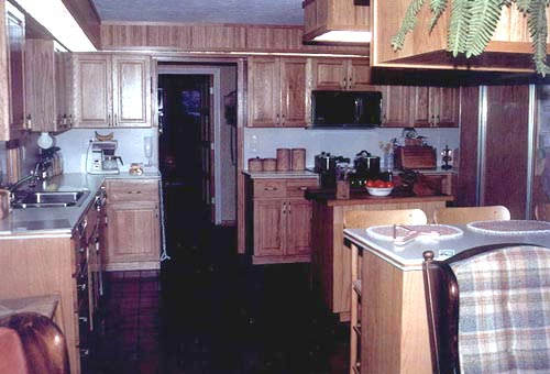 Looking back from the living room is the kitchen. Per the clients request, red oak and Corinthian was used extensively. These were accented by the quarry tile flooring.